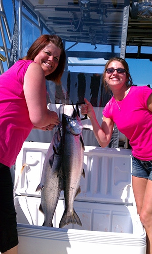 ladies fishing with Xstream Charters