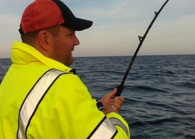 Man Charter Fishing on Lake Michigan with Xstream Charters