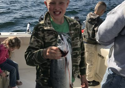 Boy with catch on Charter Fishing with Xstream Charters on Lake Michigan